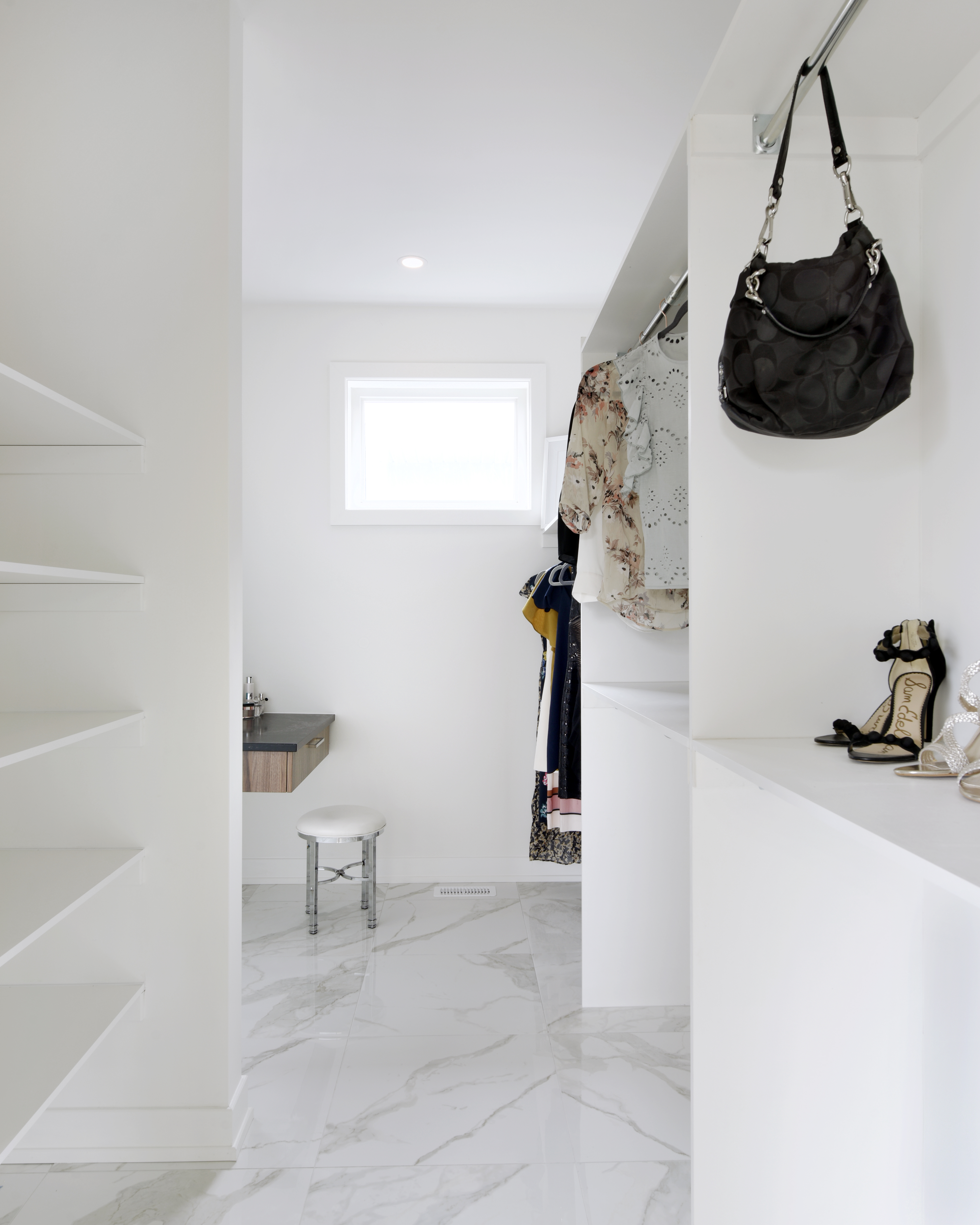 A white custom closet by Deslaurier