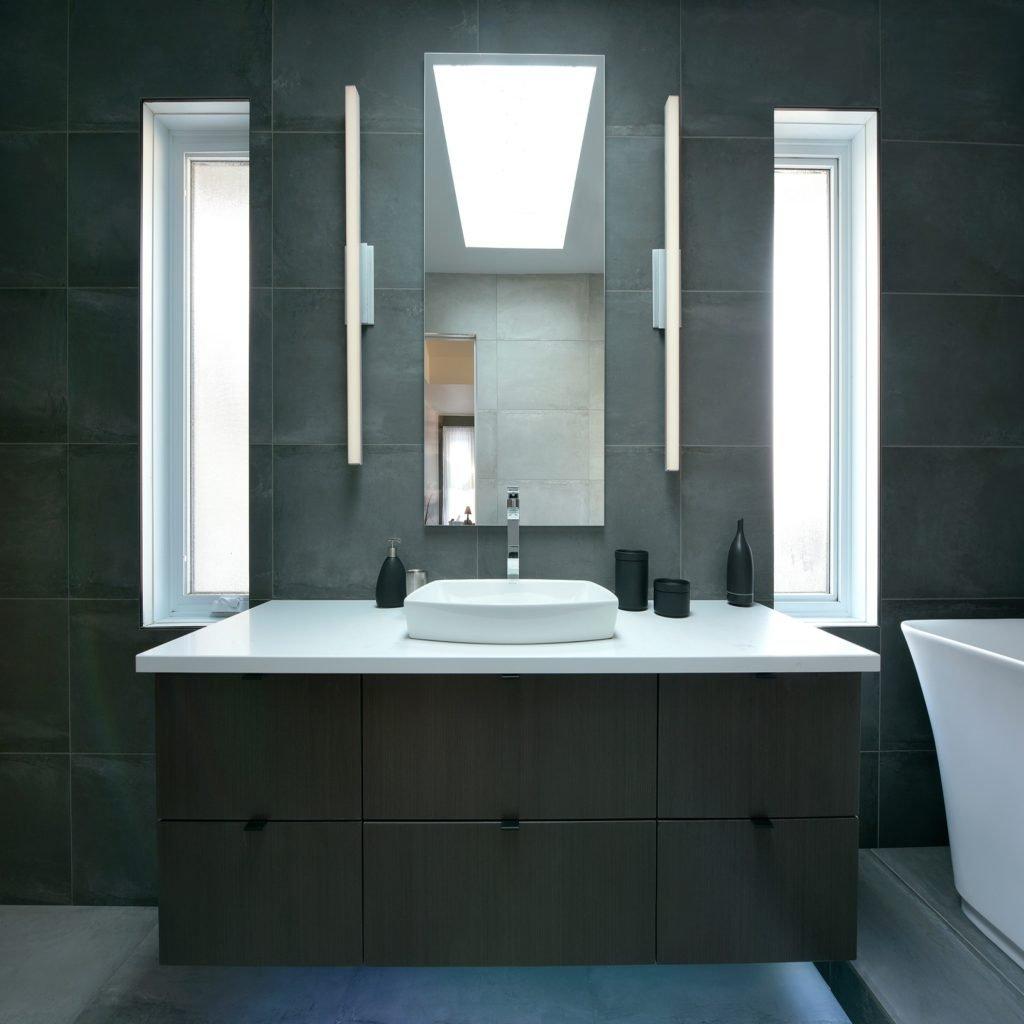 A bathroom vanity with Caesarstone countertops.