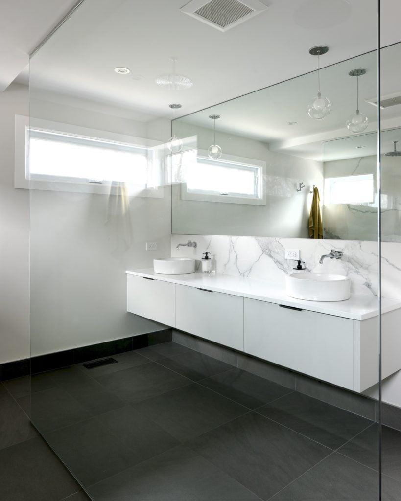 A floating custom double-sink vanity.