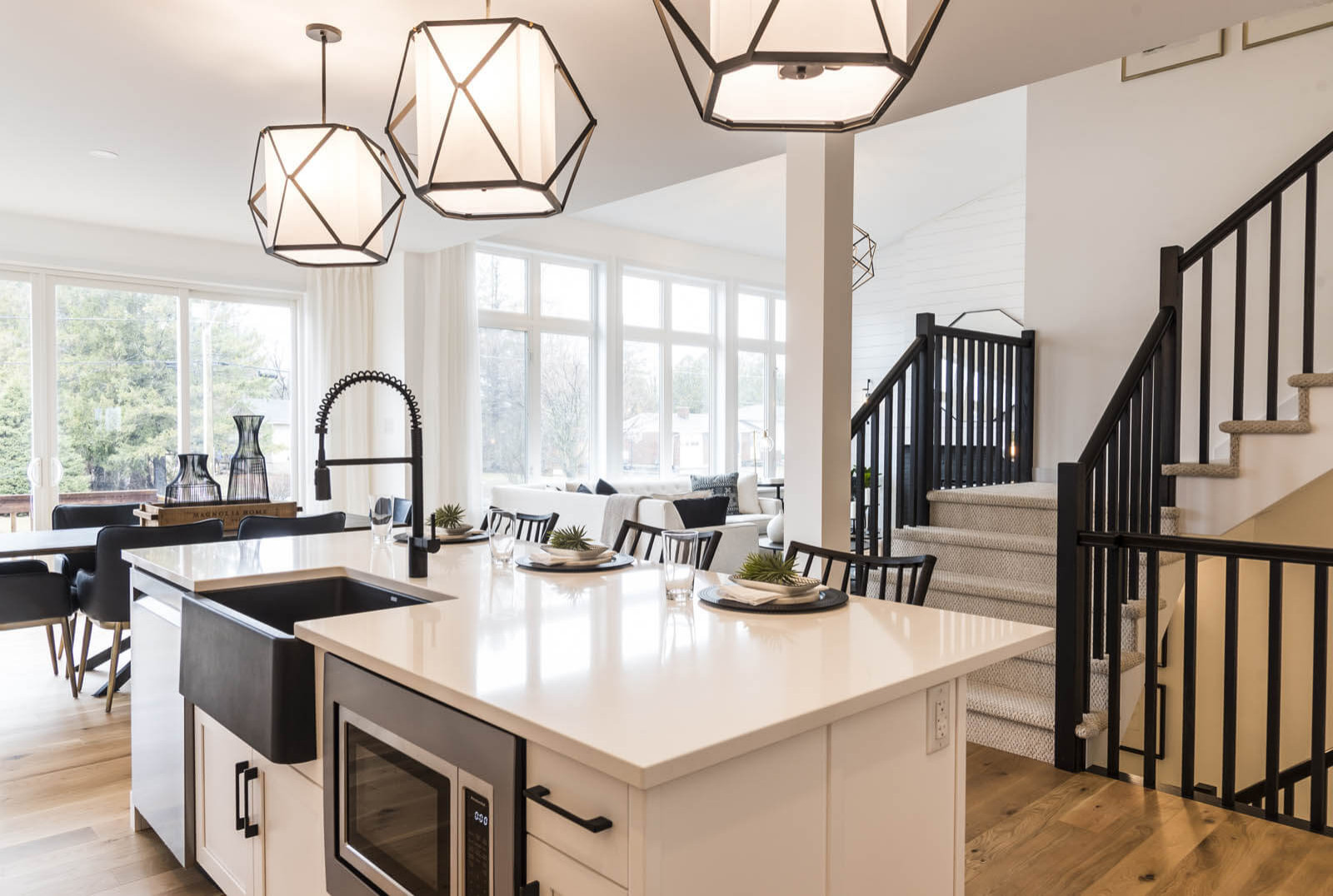 A premium kitchen island with a built-in microwave and apron-front sink