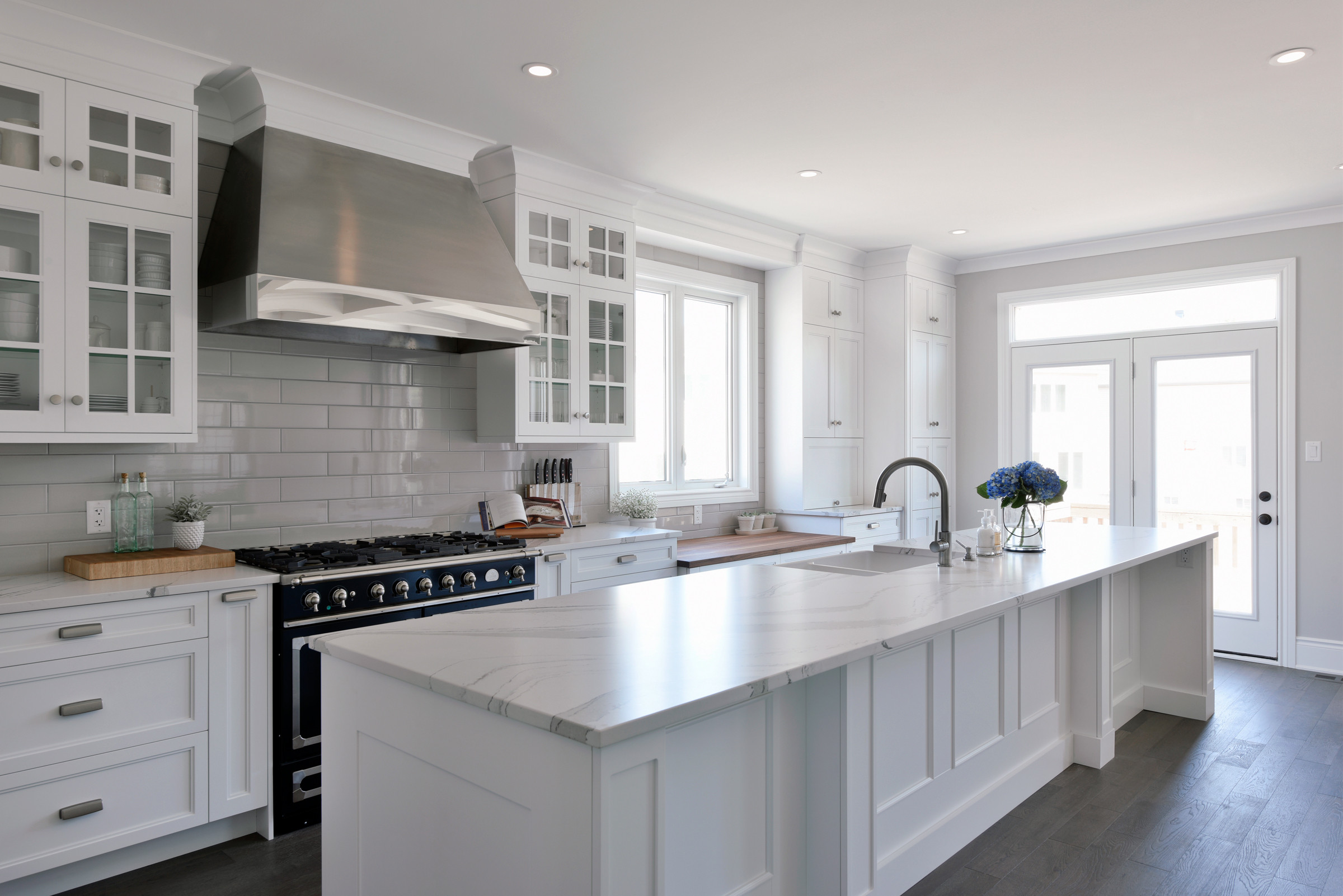 A kitchen with upper glass-front cabinets.
