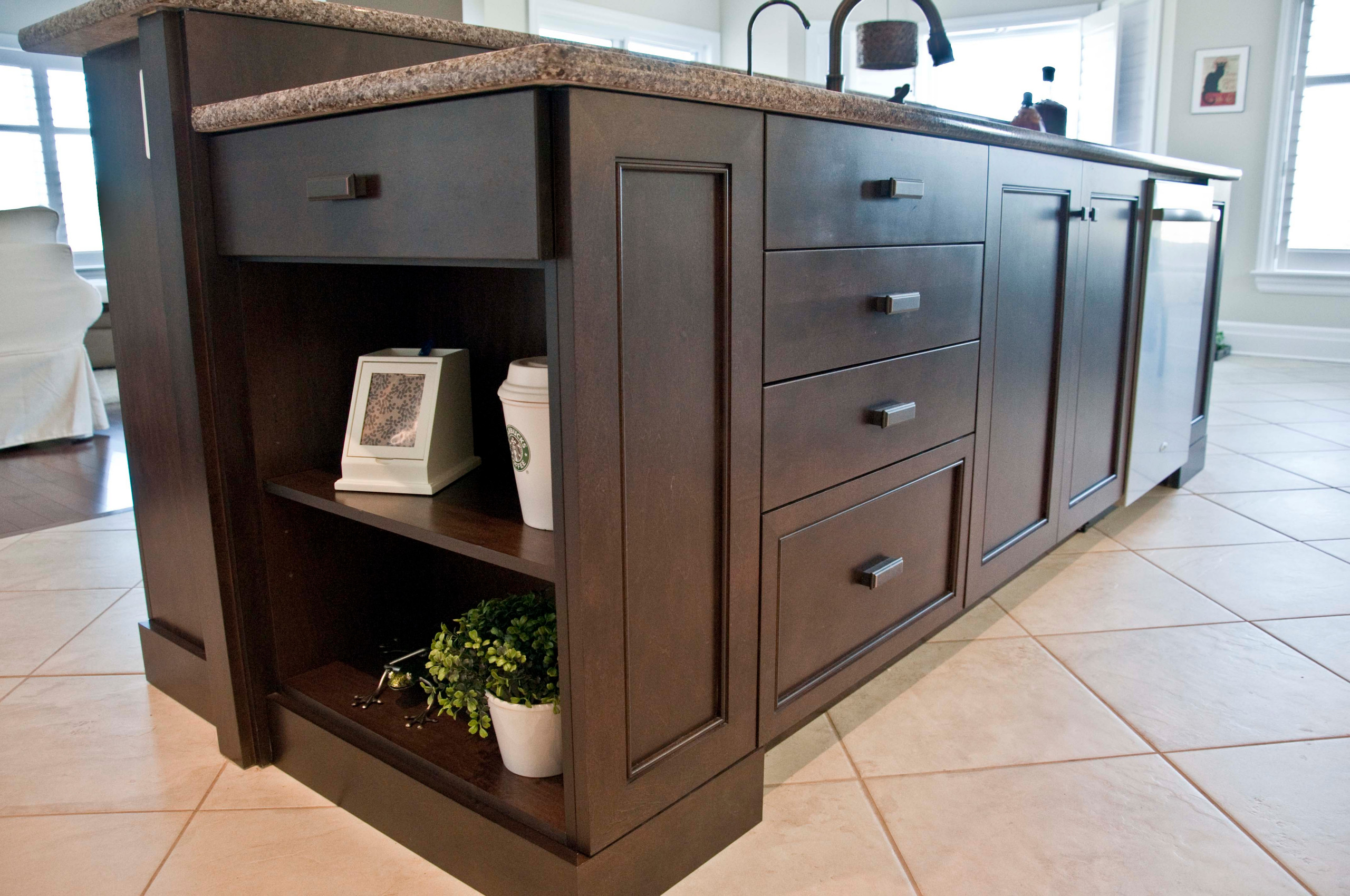 A kitchen island featuring open shelving