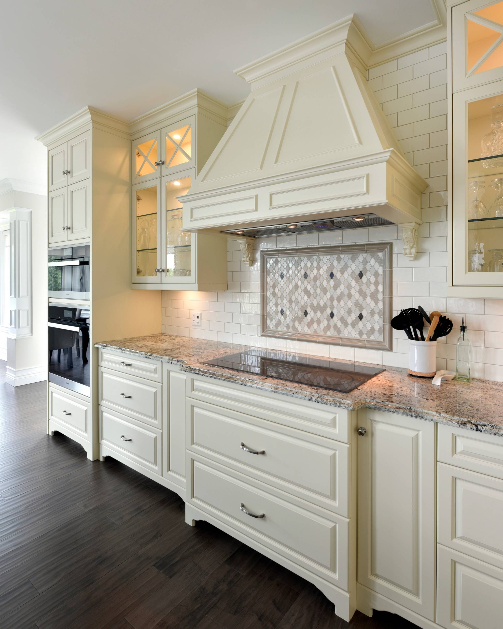 Glass cabinets with glass shelving in a traditional kitchen