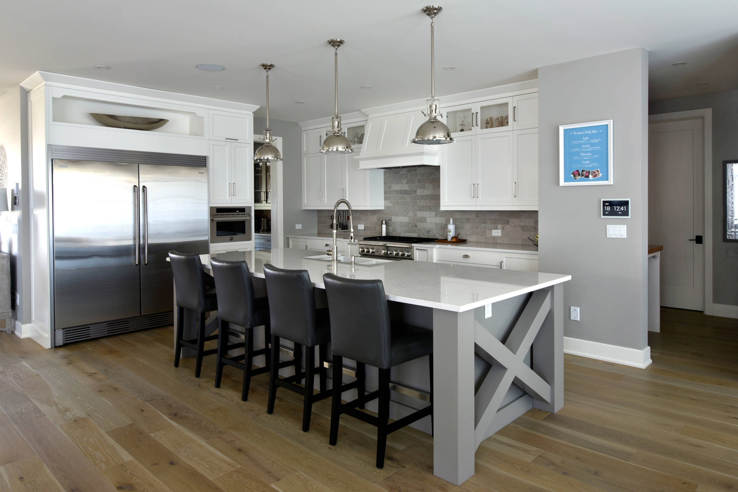 A kitchen island with a cross-pattern end panel
