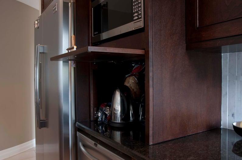 A flip-up appliance garage