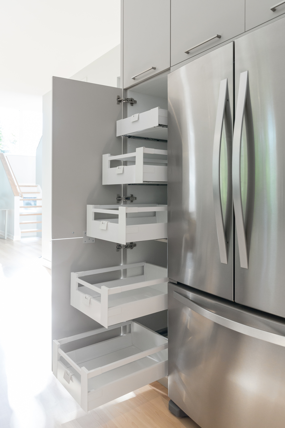 A pantry with roll-out shelves