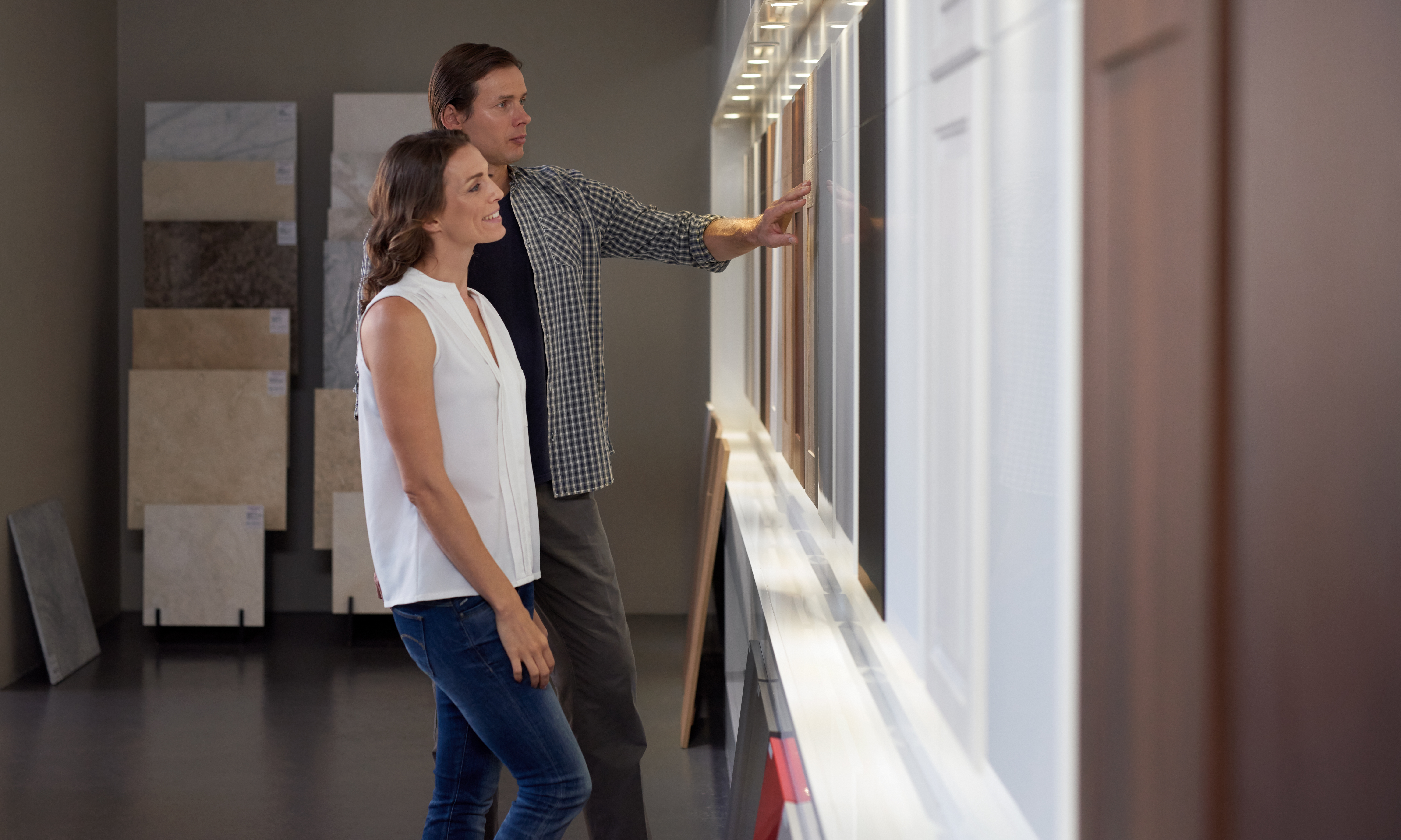 Homeowners exploring kitchen design options.