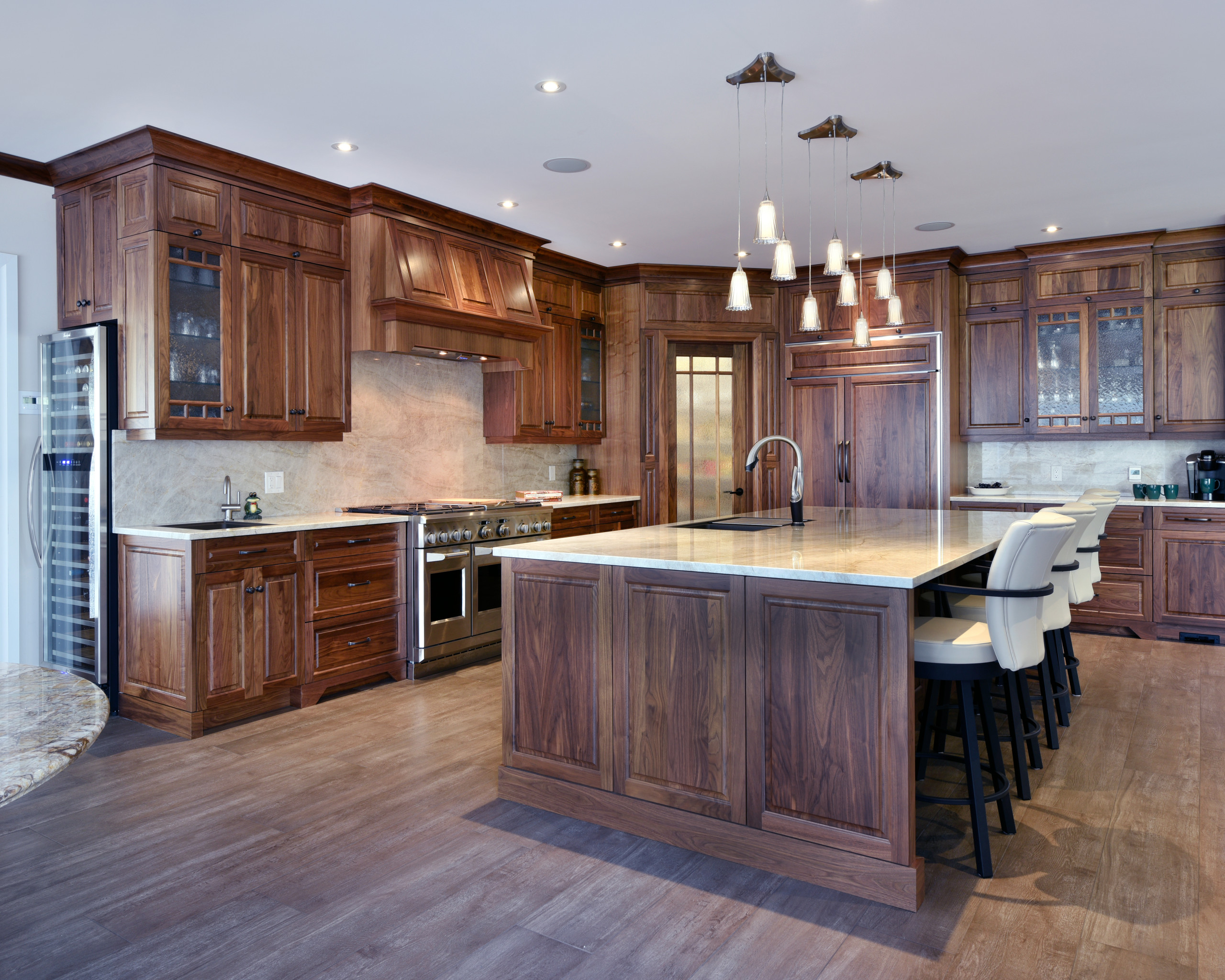 A traditional kitchen design with stained cabinets.