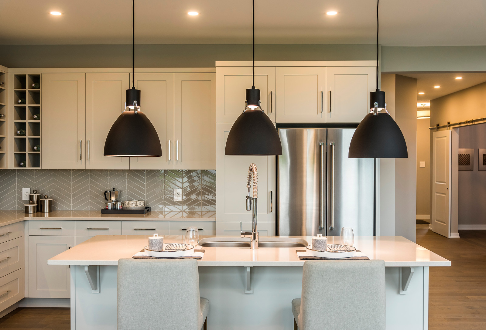 A new-build by Cardel Homes featuring Deslaurier cabinets in Fossil frey
