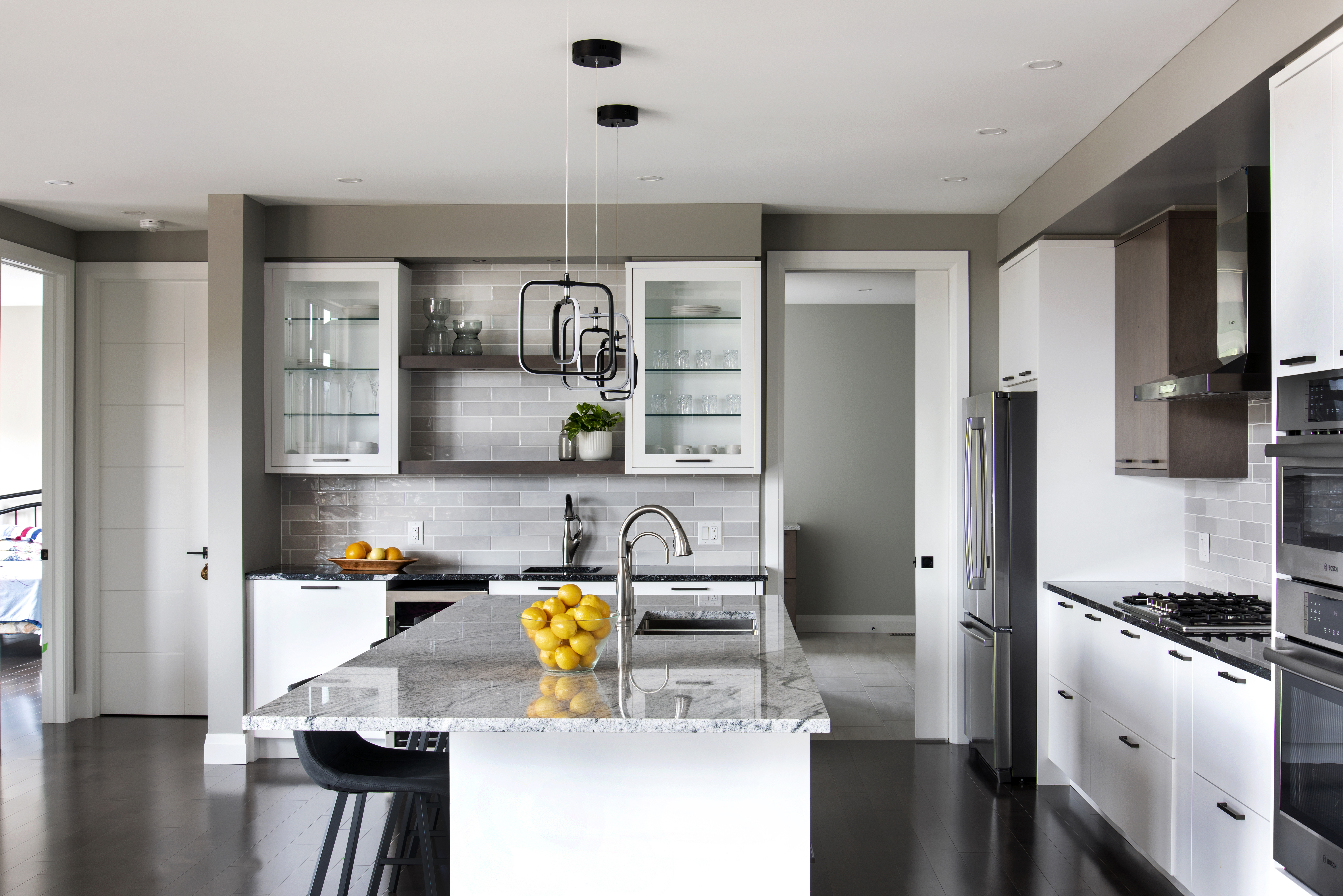 A Deslaurier kitchen with a neutral colour scheme, accented with bright fruit display pieces.