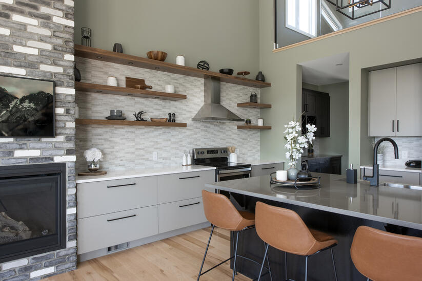 A custom kitchen featuring many open shelves in the place of upper cabinets.