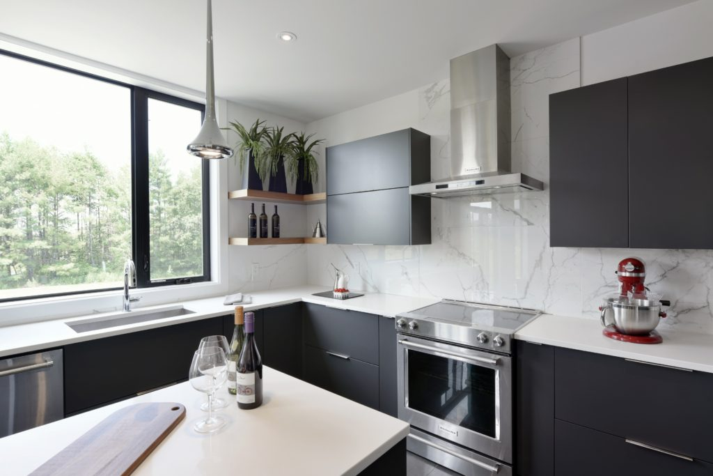 An upscale kitchen featuring modern Deslaurier cabinets.