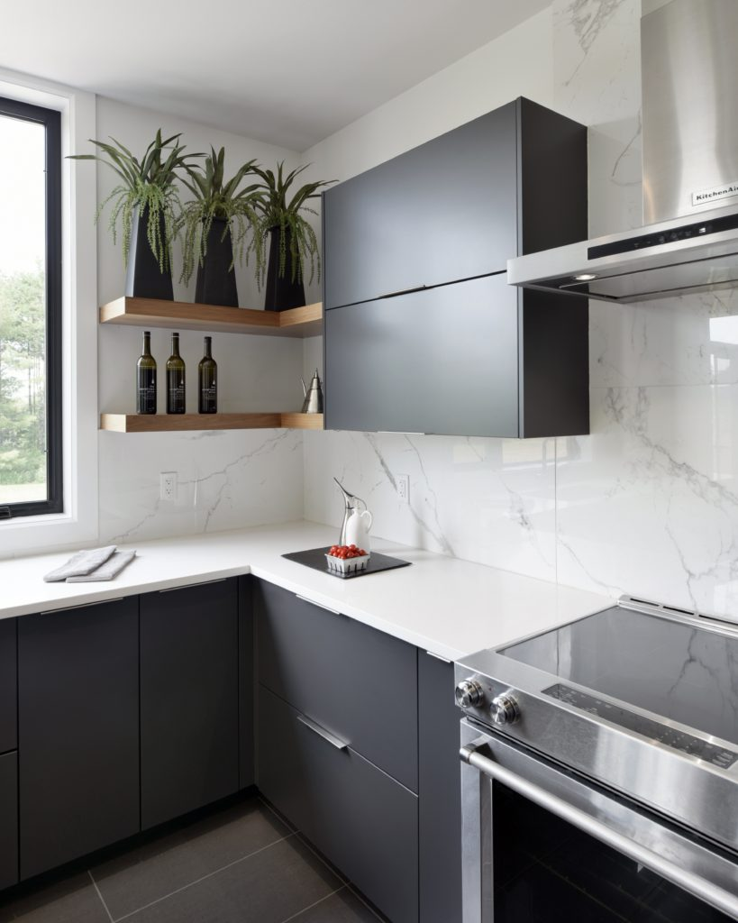 Long drawer pulls on modern black custom cabinets.