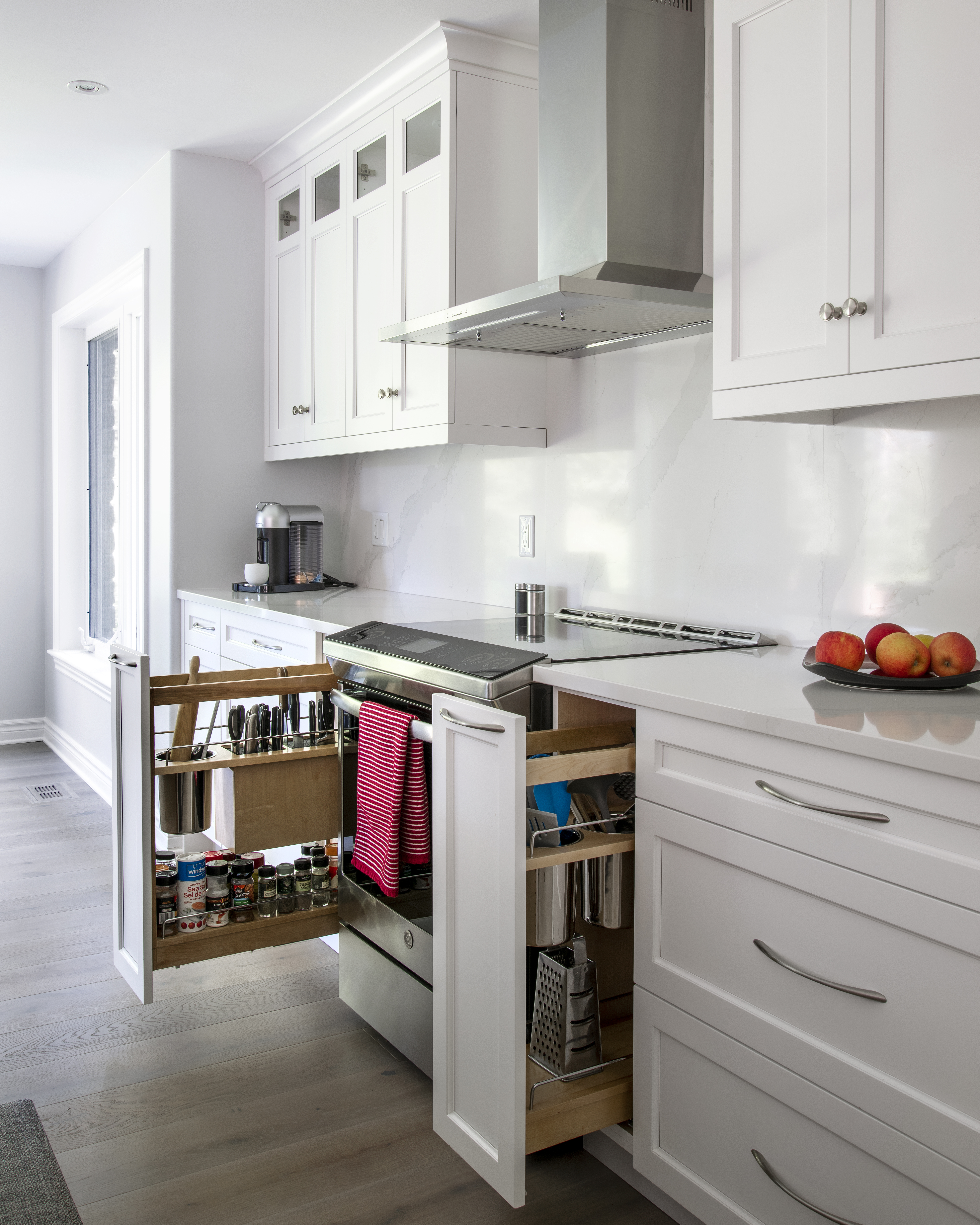 Lower cabinets featuring pull-out spice racks and utensil holders.