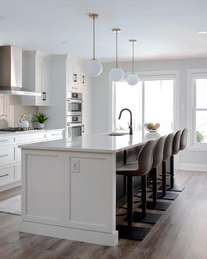 A custom kitchen island with a stone countertop
