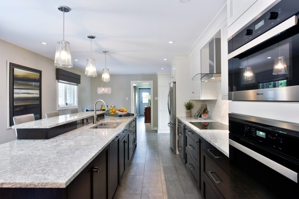 A Deslaurier design with Chocolate-stained base cabinets.