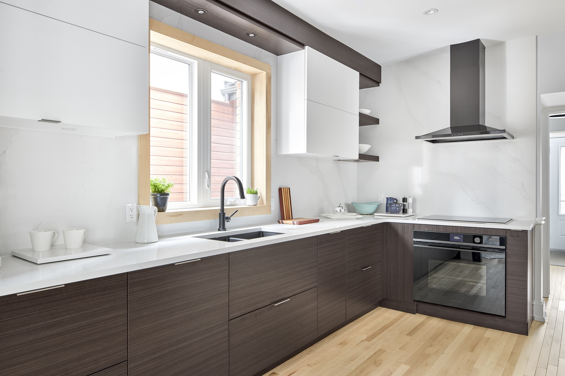A kitchen with slab-style doors