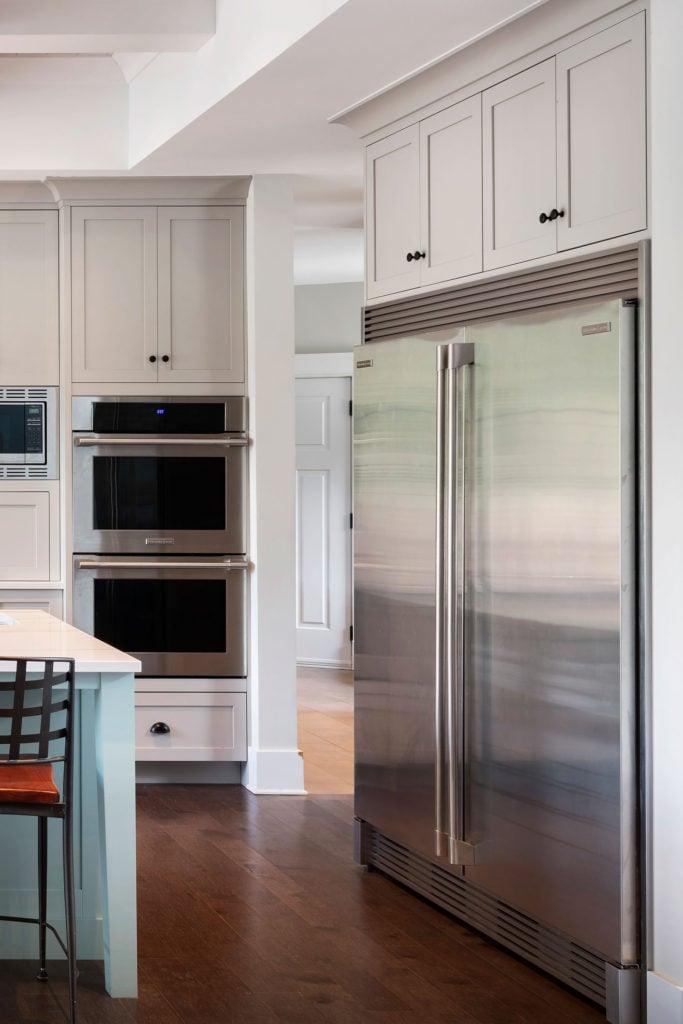 A double-door fridge built into custom cabinetry.