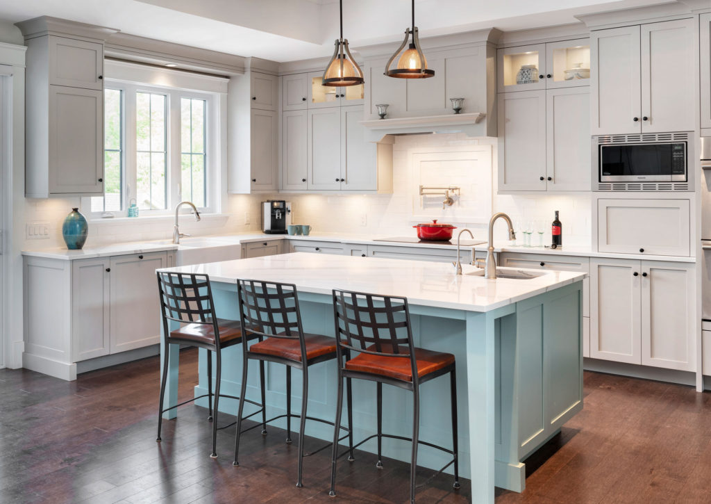 A kitchen design with painted cabinetry