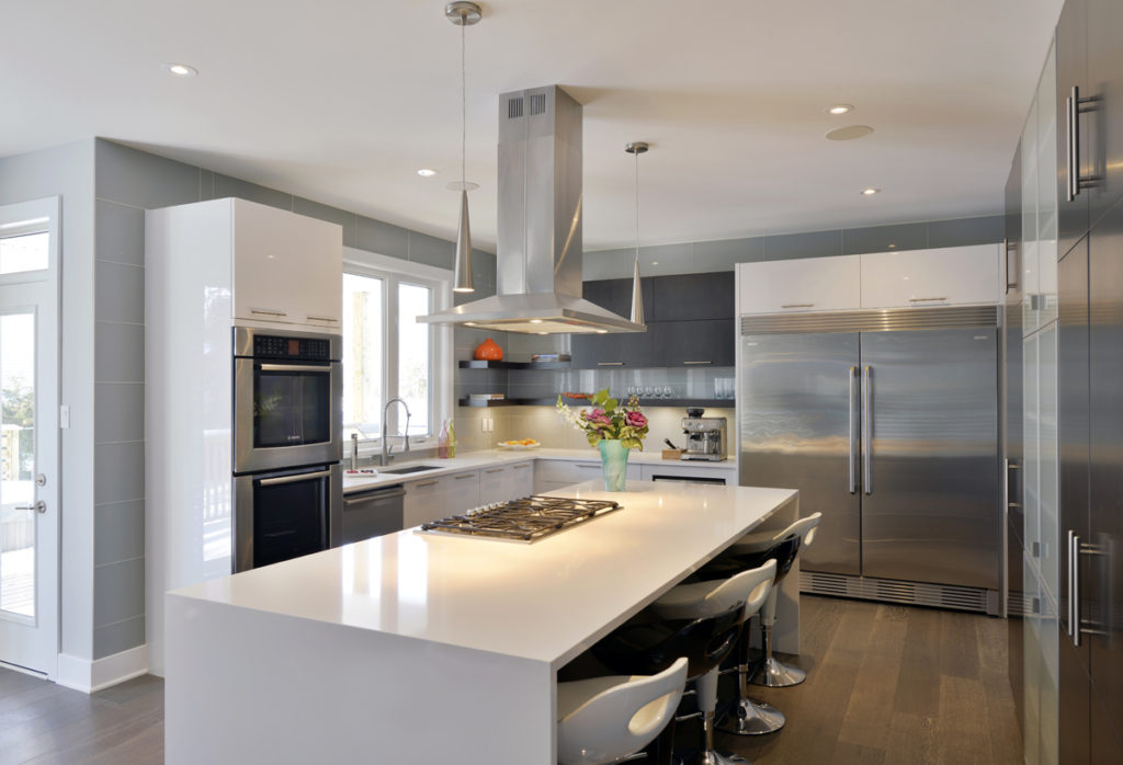 A Deslaurier kitchen with stainless steel appliances, including a double-door fridge.