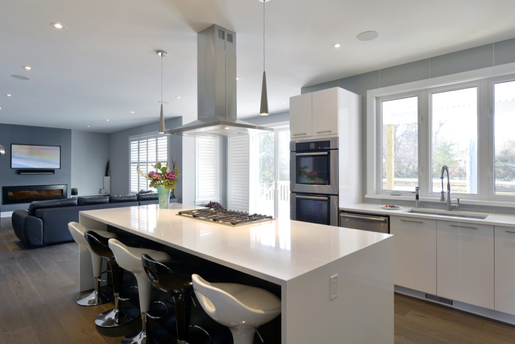 A kitchen with a cooktop on the island.