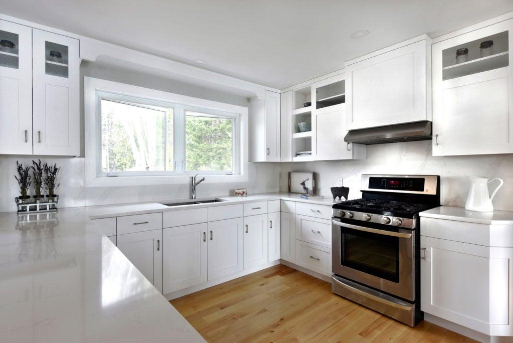 A kitchen design using multi-panel cabinet doors.