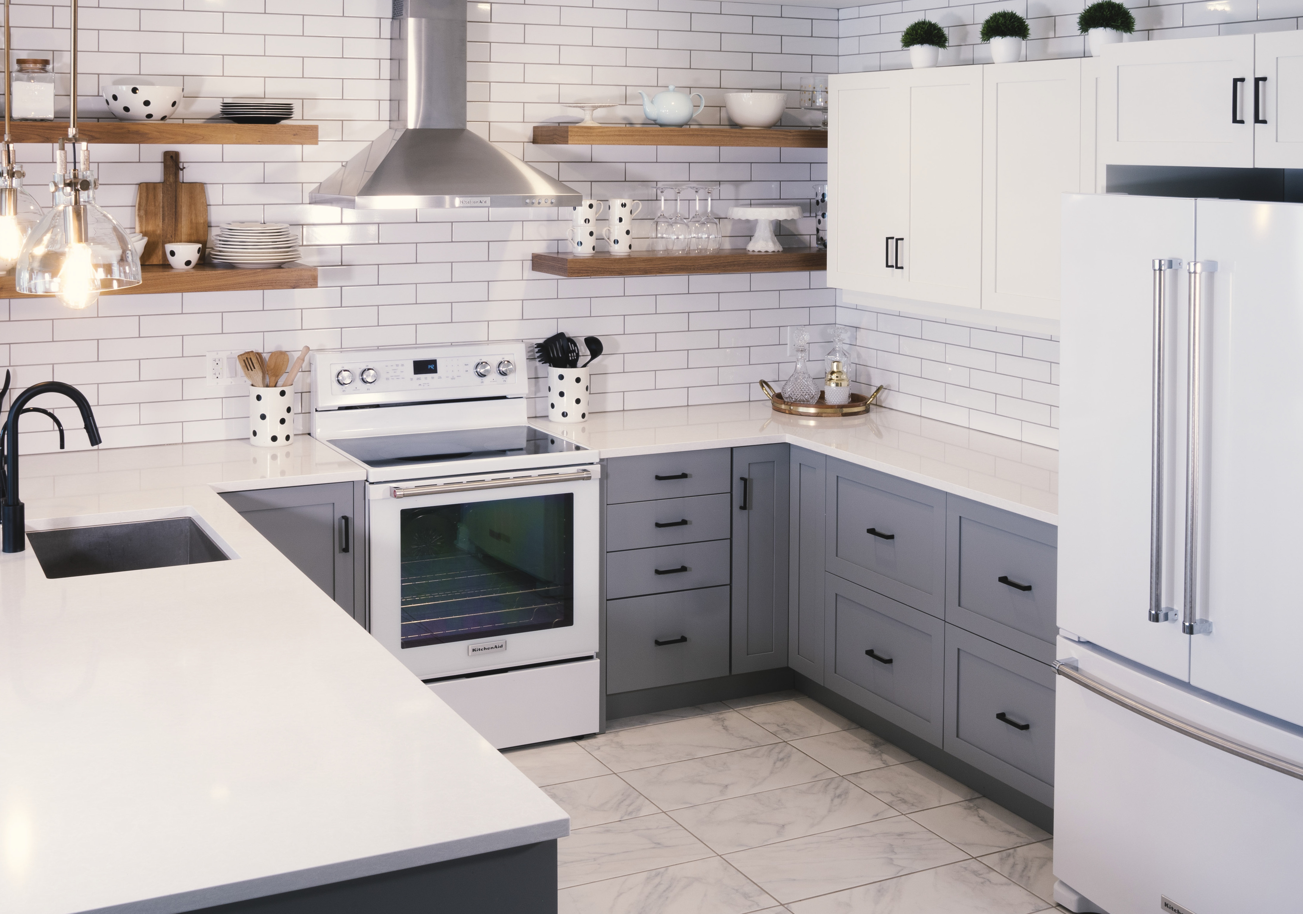 A kitchen design featuring Deslaurier's custom cabinets