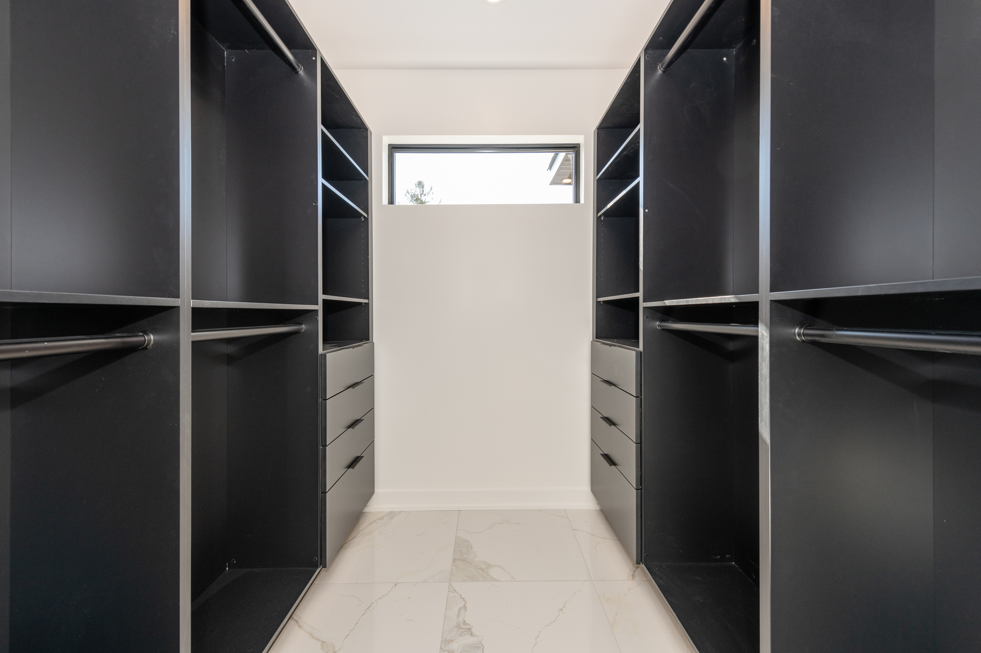 A customized master closet by Deslaurier.