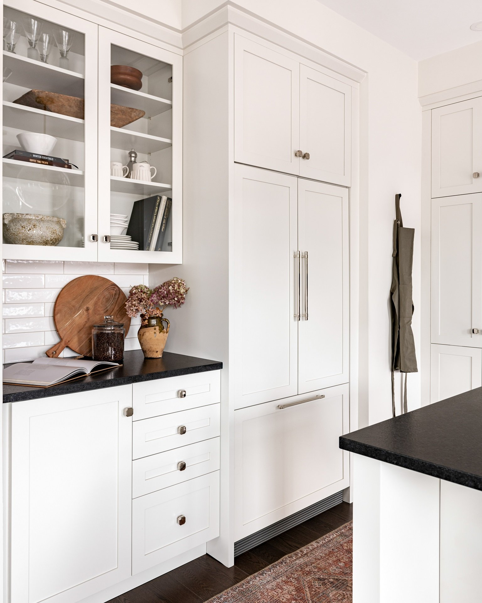 White glass cabinets with white interior shelving