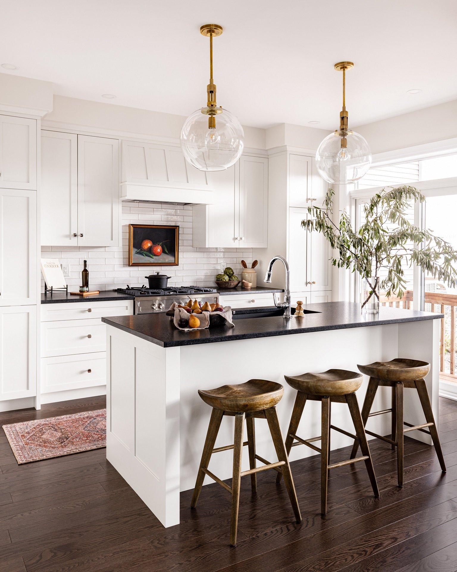 A kitchen design featuring dark countertops.