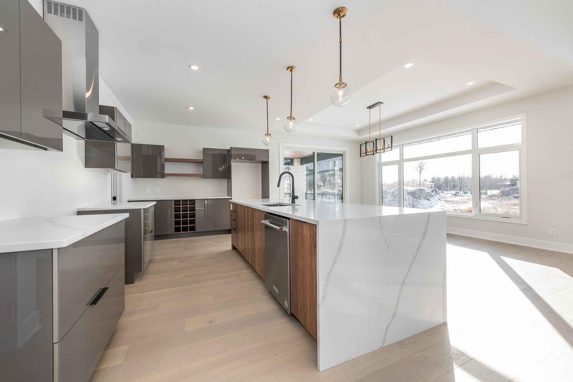 A kitchen featuring Acrylux cabinets in Grey.