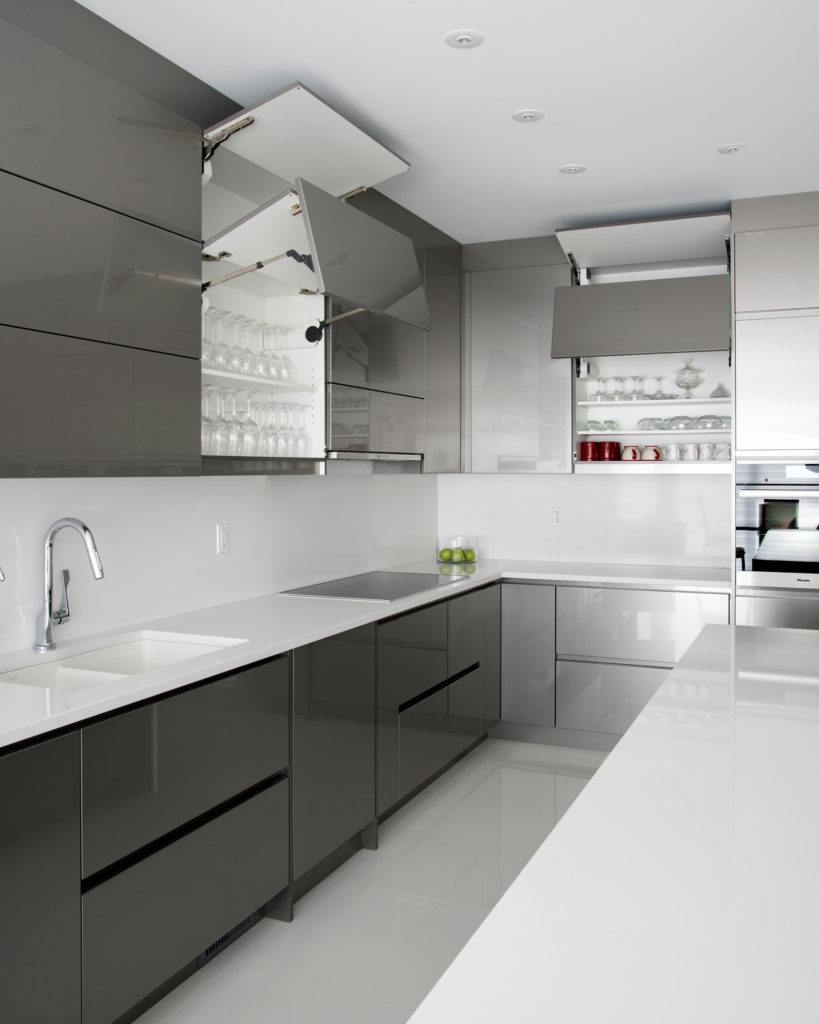 An ultra-modern kitchen with tip-on upper cabinets.