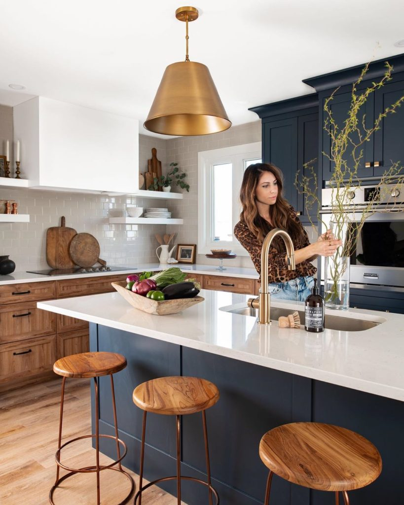A woman working on her kitchen island