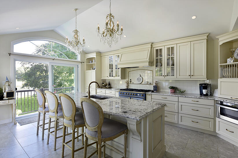 A kitchen island with traditional corbels