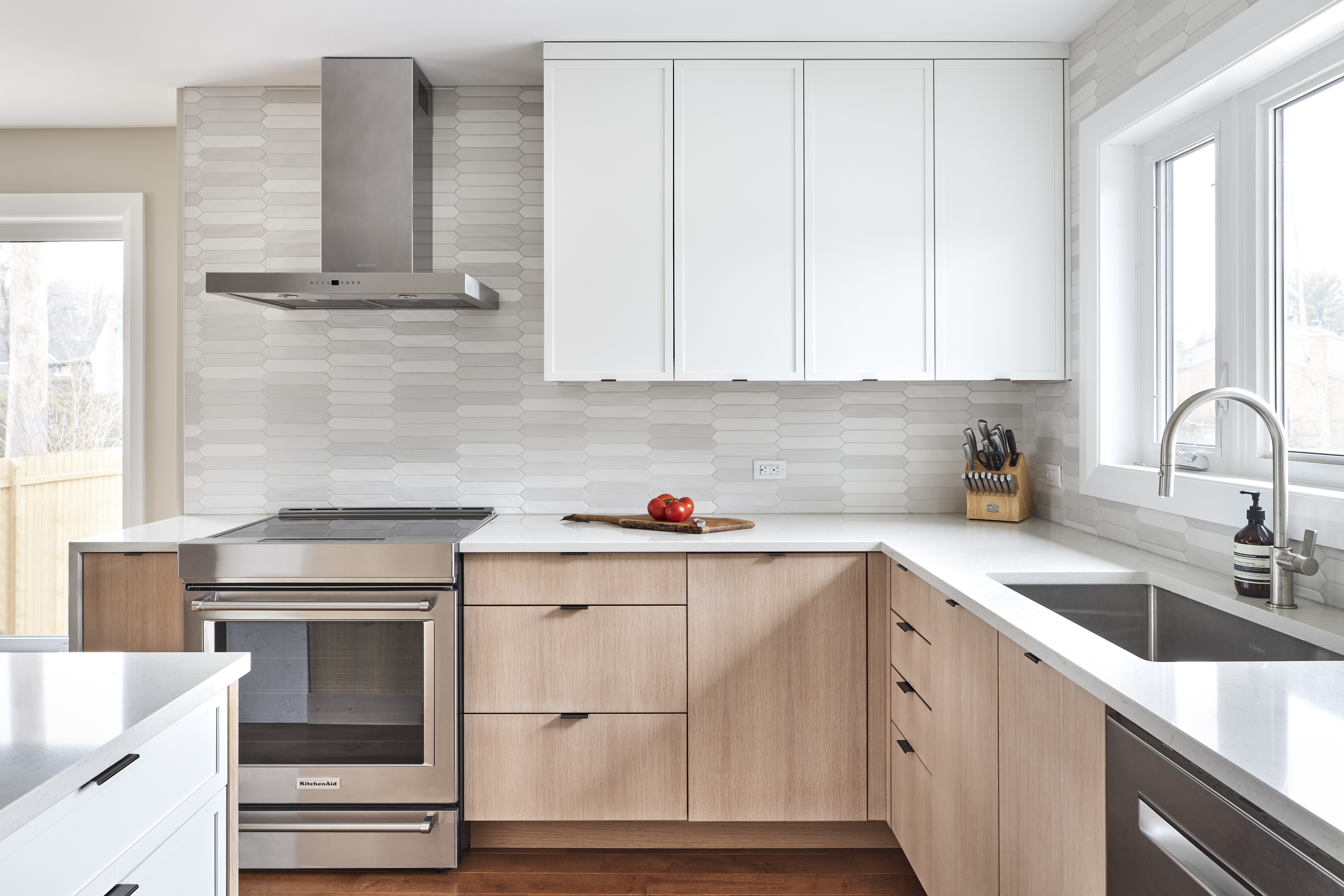 A Deslaurier design with custom cabinets painted in Wellington.