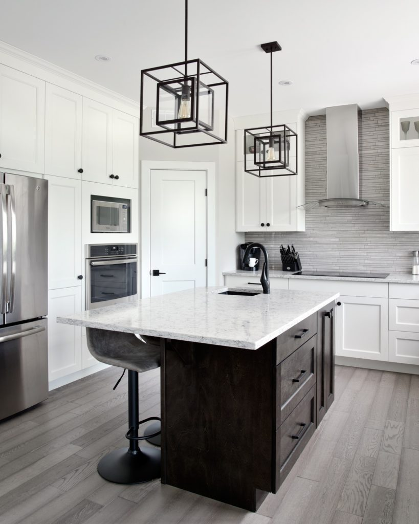 A Deslaurier kitchen with a Slate-stained kitchen island.