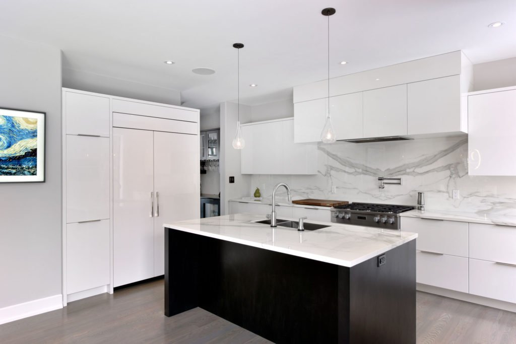 A white kitchen design featuring custom cabinets by Deslaurier