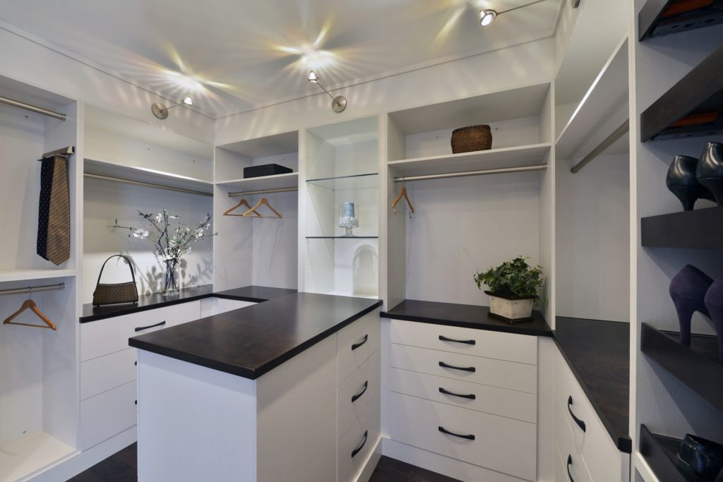 A custom closet with ample countertop space.