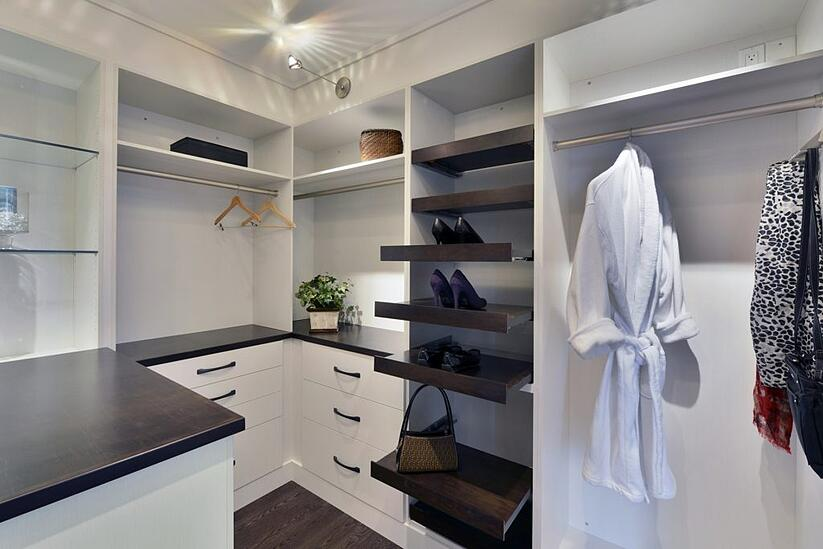A custom closet with pull-out organizers.