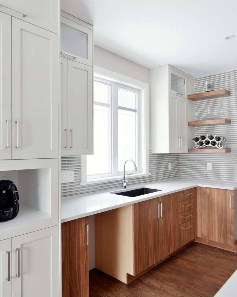 A kitchen design with stacked cabinets.