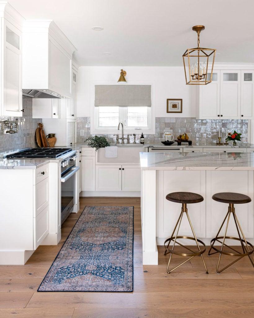 A modern kitchen design with farmhouse elements.