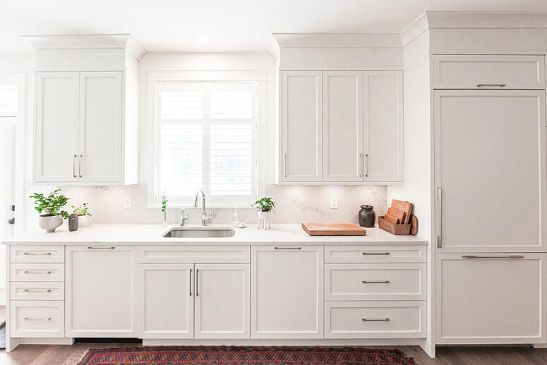 A whimsical kitchen design with white painted cabinets.