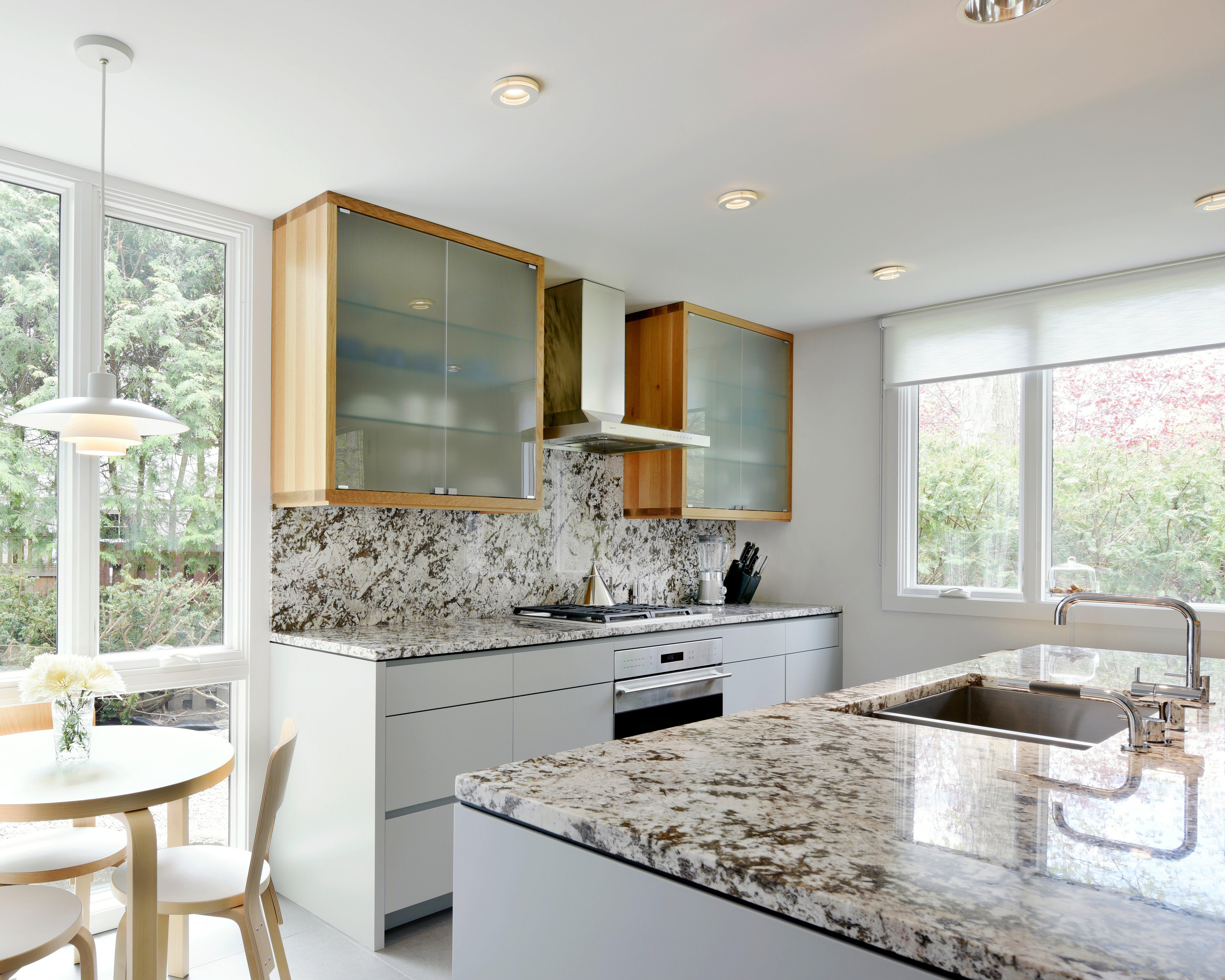A Deslaurier kitchen design featuring a full-height speckled backsplash.