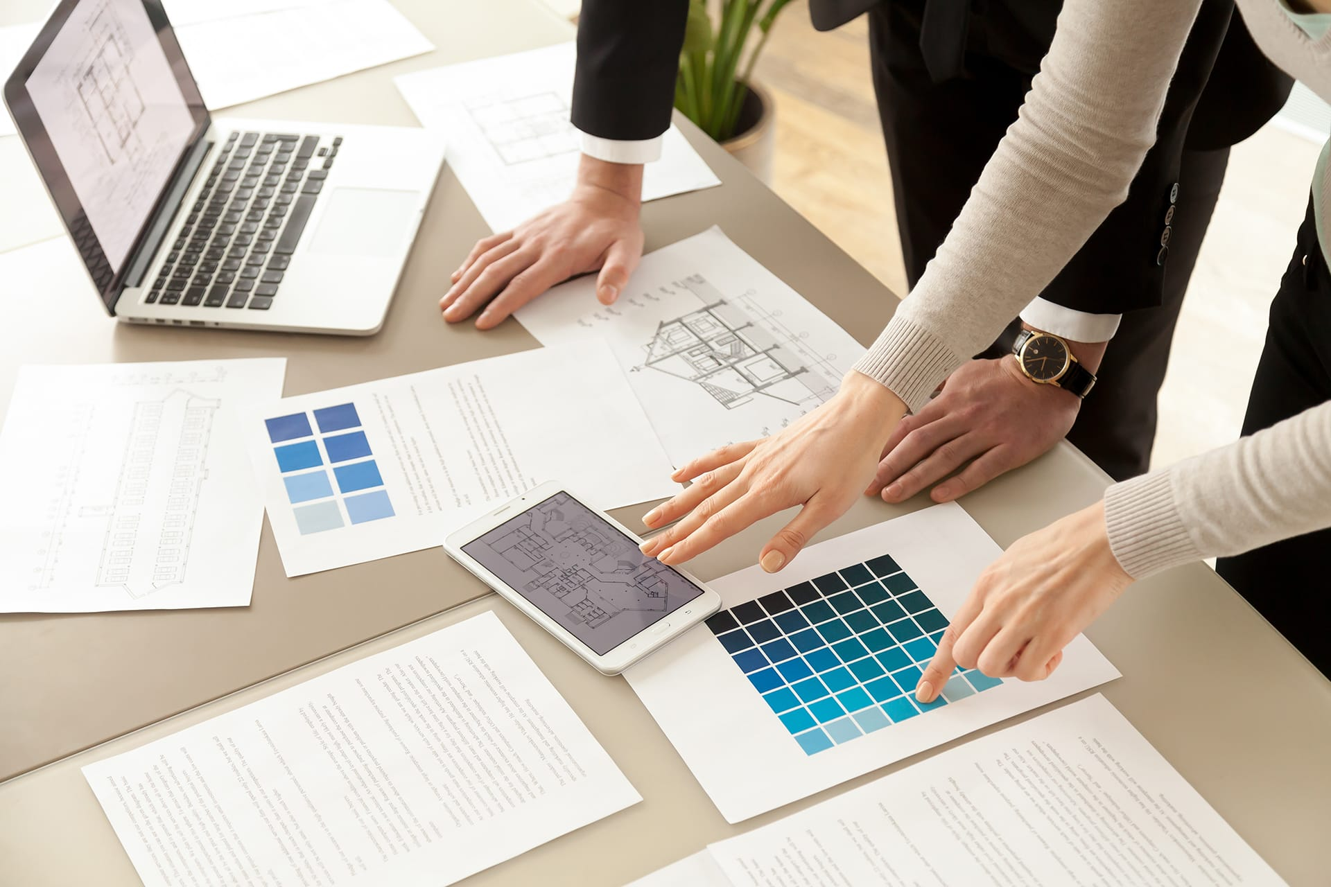 A design consultation between a homeowner and a kitchen designer.